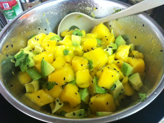 Mixing Mango Avocado Salad