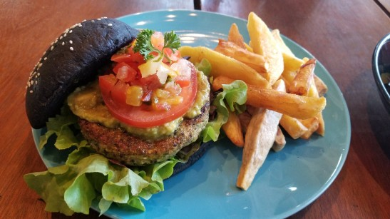 Charcoal burger with broccoli quinoa patty and fries